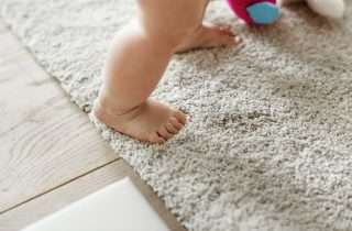 baby walking on carpet